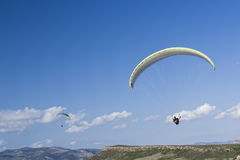 Paragliding in blue sky stock images