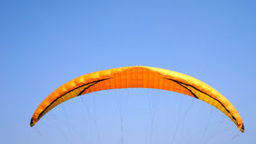 Paragliding on a clear blue sky. In a sunny day Stock Photos