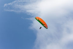 Paragliding between the clouds Stock Photography