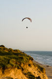 Paragliding at the coast Stock Images