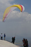 Paragliding competition in Indonesia. WONOGIRI, INDONESIA - October 13: Athletes take part in a paragliding competitions at the top of the Gajah Mungkur Stock Photo