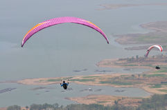 Paragliding competition in Indonesia. WONOGIRI, INDONESIA - October 13: Athletes take part in a paragliding competitions at the top of the Gajah Mungkur Stock Image