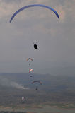 Paragliding competition in wonogiri, Indonesia. Athletes perform for the race paragliding in wonogiri, Indonesia. strong winds are necessary for athletes to be Royalty Free Stock Photos