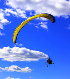 Paragliding. Experience, paragliding, ecology, summer, sun, gift, security, positive, motor, blue, joy, sky, tourism, extreme, nature, slings, flight, sport Stock Photography