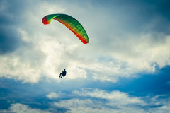 Paragliding extreme Sport with blue Sky and clouds. On background Healthy Lifestyle and Freedom concept Summer Vacations Stock Photo