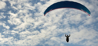 Paragliding flight with blue sky Royalty Free Stock Photo