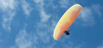 Paragliding flight with blue sky Royalty Free Stock Photography