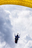 Paragliding flight in clouds Royalty Free Stock Image