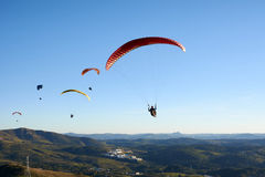 Paragliding flying over mountains Stock Images