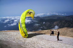 Paragliding flying. Paragliding in Turkey with mountains view and  blue sky Royalty Free Stock Image