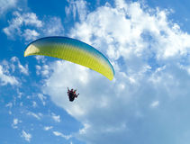 Paragliding free flying in the blue sky Royalty Free Stock Photo