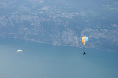 Paragliding in front of mountain landscape of Alps - Monte Baldo Stock Photography