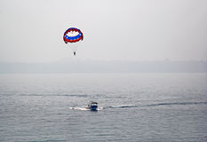 Paragliding in Goa India. Offshore paragliding by hauling by speed boat at the sea around Dona Paula in Goa, India Royalty Free Stock Photos
