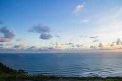 Beautiful blue ocean and sky with clouds. Paragliding hill watugupit at yogyakarta, beautiful view of hill and sea with blue sky and clouds stock photography