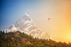 Paragliding in Himalaya. Paragliding near Machhapuchhre mount in Pokhara, Nepal Royalty Free Stock Photography