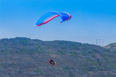 Paragliding. This image shot at Makapuu, Hawaii, a favorite spot for paragliders Royalty Free Stock Photo