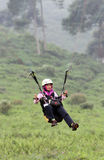 Paragliding. Landing in a field in Karanganyar, Central Java, Indonesia royalty free stock images