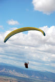 Paragliding in Macedonia. Paragliders enjoys between the clouds. Paragliding in Macedonia Royalty Free Stock Images