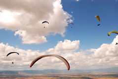 Paragliding in Macedonia. Some paragliders between the clouds. Paragliding in Macedonia Royalty Free Stock Images