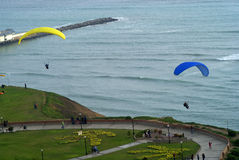 Paragliding at Miraflores Pier, Lima - Peru Royalty Free Stock Photography