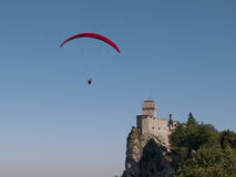 Paragliding and Monte Titano. In San Marino Stock Image