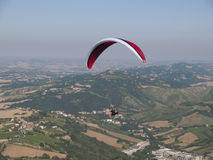 Paragliding and Monte Titano. In San Marino Royalty Free Stock Photos