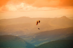 Paragliding, Mount Wellington. A paraglider floats over Mount Wellington in Tasmania, Australia Royalty Free Stock Photos