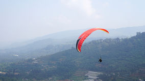 Paragliding on a mountain Stock Photo