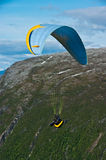 Paragliding in mountains. Side view of person paragliding in mountains, Tromso, Norway Stock Photo