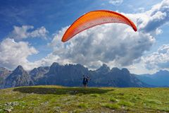 Paragliding in mountains starting. Stage royalty free stock photos