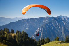 Paragliding. In the mountains and trees Stock Image