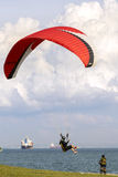 Paragliding near sea with cyclist. Stock Photography