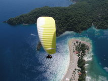 Paragliding Oludeniz. Paragliding in oludeniz,close to beautiful beach royalty free stock image