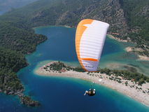 Paragliding Oludeniz. Paragliding in oludeniz,close to beautiful beach stock photography