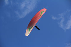 Paragliding. One guys fly in the blue sky Royalty Free Stock Photography