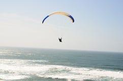 Paragliding over the Atlantic Ocean Stock Photo
