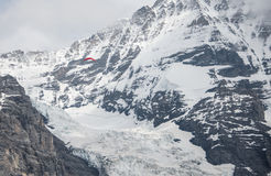 A paragliding is over the glacier. This is a photo of a paragliding is over the glacier Royalty Free Stock Photos
