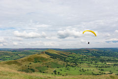 Paragliding over the hills of the Peak District Stock Photography