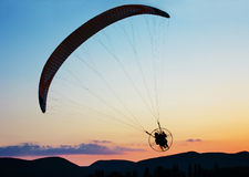 Paragliding. Over the hills at sunset Royalty Free Stock Photography
