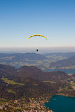 Paragliding over lake and mountains in Alps Stock Photography
