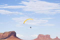 Paragliding over Monument Valley. A powered paraglider pilot in flight over Monument Valley Stock Image