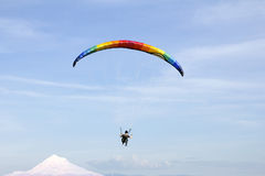 Paragliding Over Mount Hood with Blue Sky Stock Images