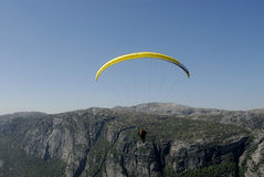 Paragliding over mountains. Picture of paraglider flying over Lysefjord in Norway Stock Photography