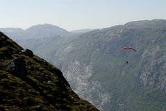 Paragliding over mountains Royalty Free Stock Images