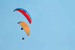 Paragliding over the mountains against sky Stock Photography