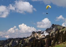 Paragliding over mountains Royalty Free Stock Photos
