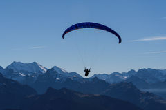 Paragliding over mountains Stock Photography