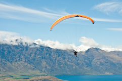 Paragliding over the mountais stock image