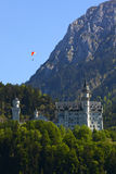 Paragliding over neuschwanstein castle Stock Photography