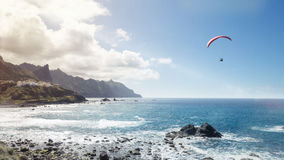 Paragliding Over The Ocean Royalty Free Stock Images